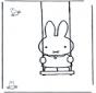 Little rabbit on swing